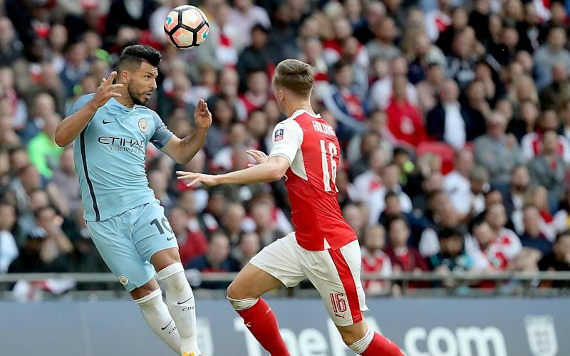 Aguero heads against Arsenal - Credit: EPA