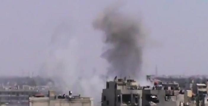 This image made from amateur video released by the Shaam News Network and accessed Thursday, June 21, 2012, purports to show smoke rising from buildings in Homs, Syria. A spokeswoman for the International Committee of the Red Cross says aid workers teams will try to evacuate wounded and sick civilians and those who want to leave rebel-held areas in the embattled central Syrian city of Homs. (AP Photo/Shaam News Network via AP video) TV OUT, THE ASSOCIATED PRESS CANNOT INDEPENDENTLY VERIFY THE CONTENT, DATE, LOCATION OR AUTHENTICITY OF THIS MATERIAL