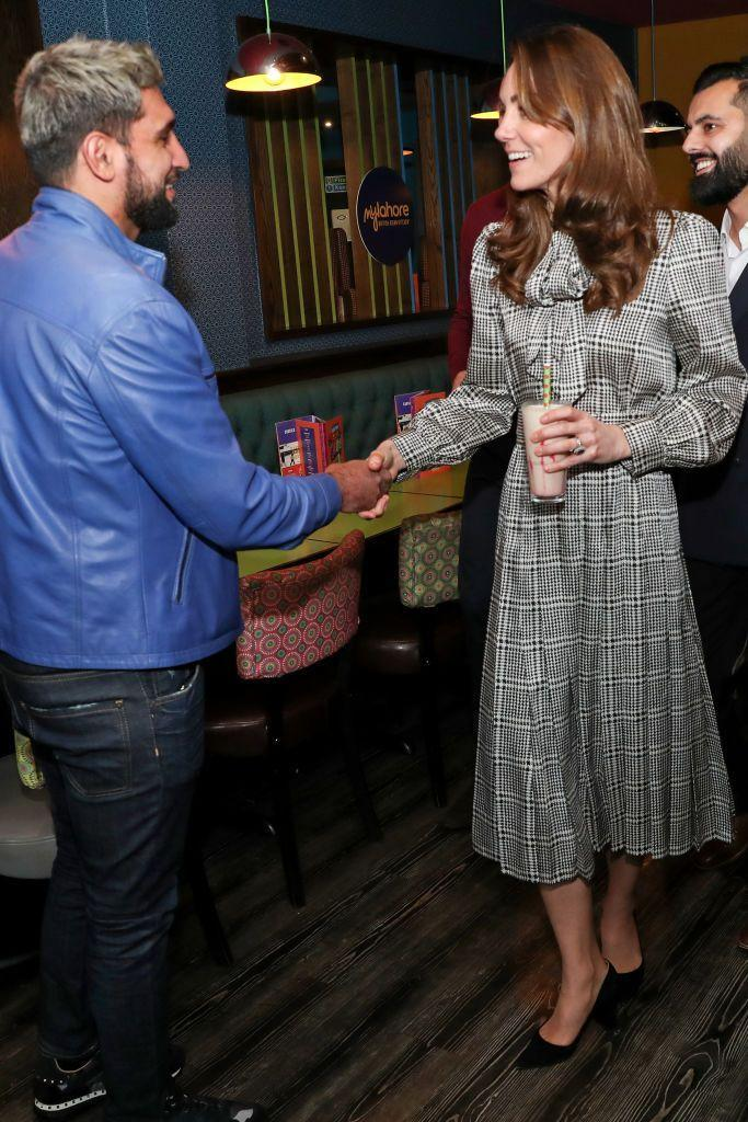 <p>The Duchess of Cambridge meet with Amir Khan during a visit to MyLahore's flagship restaurant. She wore a Zara dress. </p>