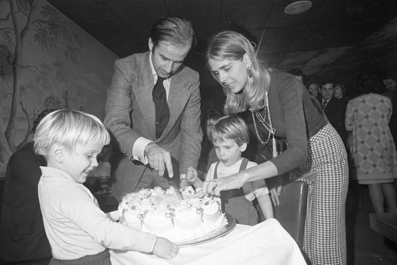 Senator-elect Joseph Biden and wife Neilia cut his 30th birthday cake at a party in Wilmington, Delaware, on 20 November 1972. Their son Hunter waits for the first piece (Getty)