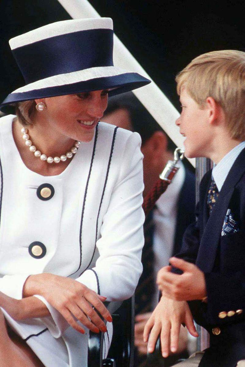 <p>With Prince Harry in a navy-and-white structured top hat.</p>
