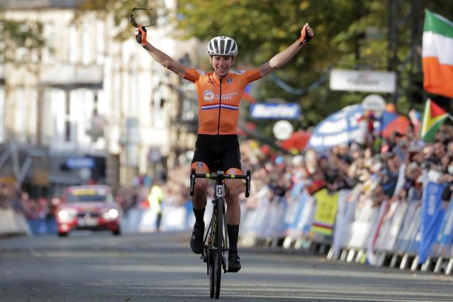 Annemiek van Vleuten, of The Netherlands, celebrates as she crosses the finish line to win the women elite race, at the road cycling World Championships in Harrogate, England, Saturday, Sept. 28, 2019. (AP Photo/Manu Fernandez)