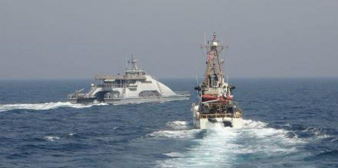 Iran's Navy of the Army of the Islamic Revolutionary Guard (IRGCN) Haas 55 (left) has a US vessel on April 2 on a regular maritime security patrol in the high seas of the southern Arabian Gulf.