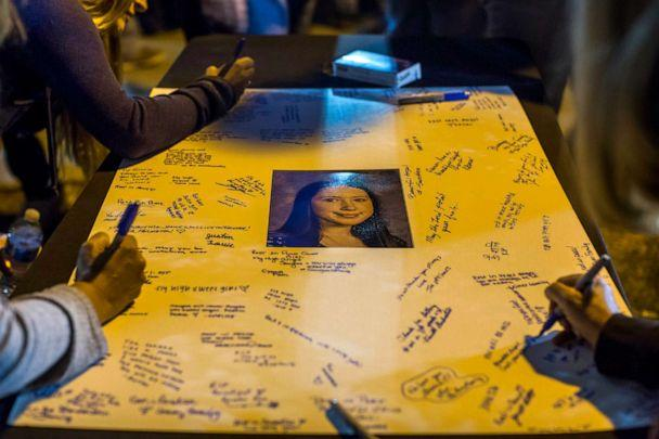 PHOTO: Mourners leave messages on a poster at a vigil held for shooting victims, Nov. 17, 2019, in Santa Clarita, California. (Apu Gomes/Getty Images)