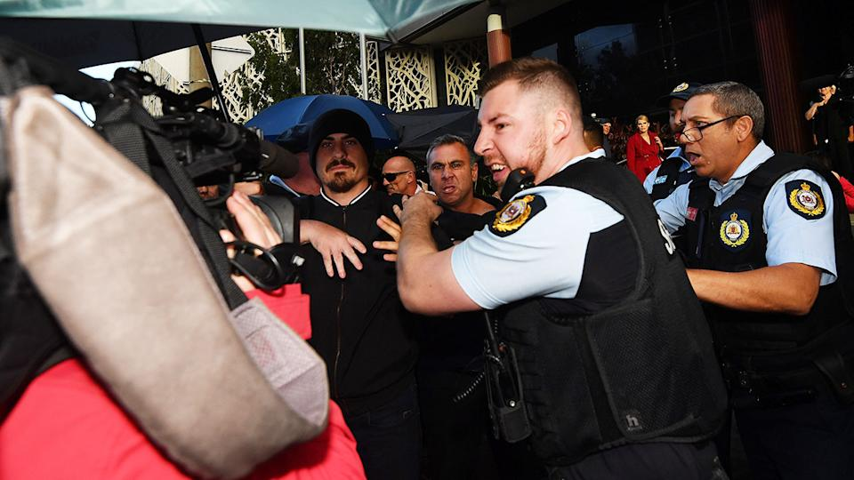 Supporters, members of the media and police officers, pictured here jostling after the sentencing of Jarryd Hayne.