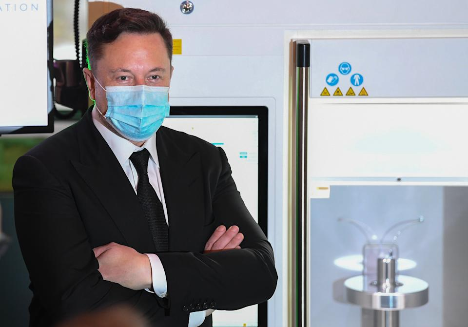 BERLIN, GERMANY - SEPTEMBER 02:  Tesla and SpaceX CEO Elon Musk presents a vaccine production device during the CDU/CSU faction meeting the Westhafen Event & Convention Center on September 2, 2020 in Berlin, Germany. Germany. Musk is currently in Germany where he met with vaccine maker CureVac, with which Tesla has a cooperation to build devices for producing RNA vaccines, yesterday. Today, he is rumoured to also be visiting the site of the new Gigafactory under construction near Berlin. (Photo by Filip Singer-Pool/Getty Images