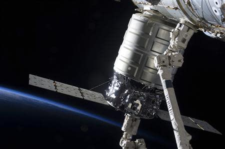Attached to the Harmony node, the first Cygnus commercial cargo spacecraft built by Orbital Sciences Corp., in the grasp of the Canadarm2