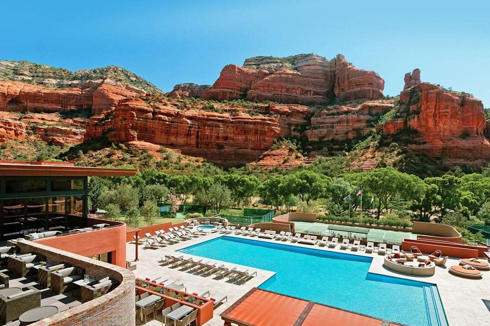 """<p><a class=""""link rapid-noclick-resp"""" href=""""https://www.enchantmentresort.com/"""" rel=""""nofollow noopener"""" target=""""_blank"""" data-ylk=""""slk:BOOK NOW"""">BOOK NOW</a></p><p><strong>Location:</strong> <a href=""""https://www.sedona.net/"""" rel=""""nofollow noopener"""" target=""""_blank"""" data-ylk=""""slk:Sedona, Arizona"""" class=""""link rapid-noclick-resp"""">Sedona, Arizona</a></p><p>Escape to the red rock canyons of Sedona, the spiritual heart of the state, to indulge in Southwestern splendor and self-care. Explore 70 acres of sweeping grounds graced with a guided labyrinth walk and a large suite of athletic options. The destination boasts 218 one-story suites all adorned in chic rustic flair. Indulge in locally grown American cuisine with a Native American influence, paired with an award-winning wine list.</p><p>It's essential to note that the Enchantment Resort is also <a href=""""https://www.miiamo.com/"""" rel=""""nofollow noopener"""" target=""""_blank"""" data-ylk=""""slk:Mii Amo"""" class=""""link rapid-noclick-resp"""">Mii Amo</a>'s temporary mind, body, and soul specialist hub while the renowned wellness retreat mindfully pauses operations for renovations. It has the typical spa treatments, massages, wraps, and facials, but is primarily known for its unique woo therapies, like aura photography, soma (a therapy that uses color to reveal our divine talents), chakra clearing, and sound healing.</p>"""