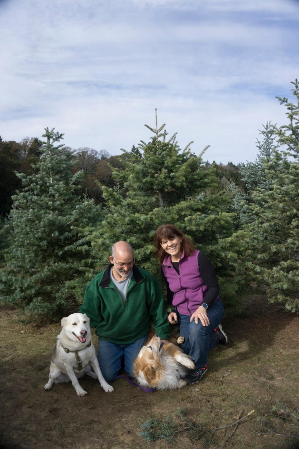 Terry Feinberg, his wife Carla Ruigh, and their rescue dogs from Chrismas 2017. The couple prefers to donate to charities instead of exchange physical gifts during Christmas. (Photo courtesy of Terry Feinberg.)