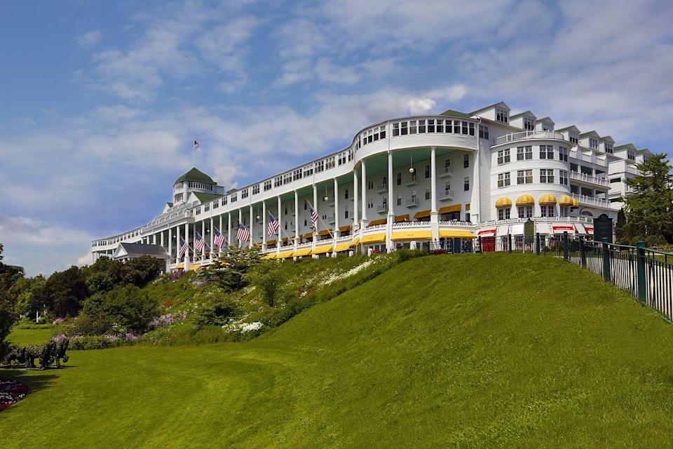 "<p>Between <span class=""redactor-unlink"">Michigan's</span> Upper and Lower Peninsulas, tiny Mackinac Island is home to this sprawling resort, overlooking crystal-clear Lake Huron. Five <a href=""https://www.elledecor.com/celebrity-style/a17046114/kehinde-wiley-obama-portrait/"" rel=""nofollow noopener"" target=""_blank"" data-ylk=""slk:U.S. presidents"" class=""link rapid-noclick-resp"">U.S. presidents</a> have stayed at this majestic establishment, which opened in 1887, and has dazzled visitors with its lavishly decorated rooms, sublime service, and superlative front porch — the longest in the world at nearly 660 feet.<br></p><p><strong>EXPLORE NOW:</strong> <a href=""https://www.tripadvisor.com/Hotel_Review-g42423-d218337-Reviews-Grand_Hotel-Mackinac_Island_Mackinac_County_Upper_Peninsula_Michigan.html"" rel=""nofollow noopener"" target=""_blank"" data-ylk=""slk:The Grand Hotel"" class=""link rapid-noclick-resp"">The Grand Hotel</a></p>"