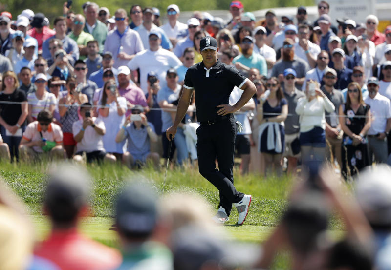 Brooks Koepka waits to putt on the first green during the third round of the PGA Championship golf tournament, Saturday, May 18, 2019, at Bethpage Black in Farmingdale, N.Y. (AP Photo/Andres Kudacki)
