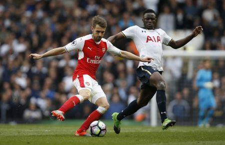 Britain Football Soccer - Tottenham Hotspur v Arsenal - Premier League - White Hart Lane - 30/4/17 Arsenal's Aaron Ramsey in action with Tottenham's Victor Wanyama Action Images via Reuters / Paul Childs Livepic