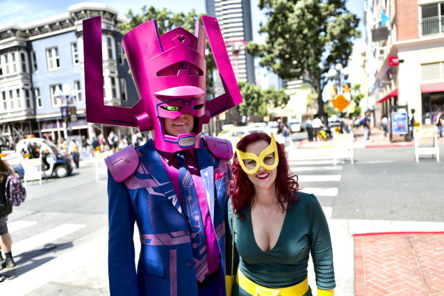 <p>Steve and Michelle Gormally of Atlanta dressed as Galactus and Marvel Girl at Comic-Con International on July 19, 2018, in San Diego. (Photo: Richard Vogel/AP) </p>