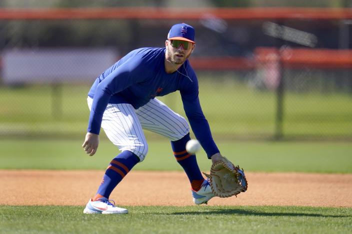 New York Mets infielder Pete Alonso handles a grounder during spring training baseball practice Tuesday, Feb. 23, 2021, in Port St. Lucie, Fla. (AP Photo/Jeff Roberson)