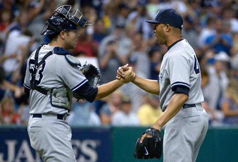 New York Yankees reliever Mariano Rivera, right, is congratulated by catcher Austin Romine after getting the save in a 3-2 victory over the Tampa Bay Rays in a baseball game in St. Petersburg, Fla., Sunday, Aug. 25, 2013. (AP Photo/Phelan M. Ebenhack)