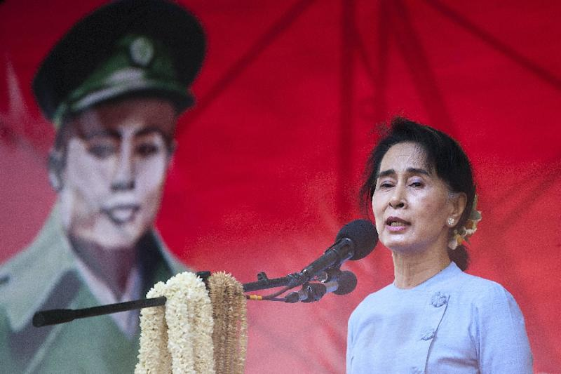 Aung San Suu Kyi addresses supporters during a rally in May, the portrait of her father General Aung San, independence hero assassinated on July 19, 1947, in the background (AFP Photo/Ye Aung Thu)
