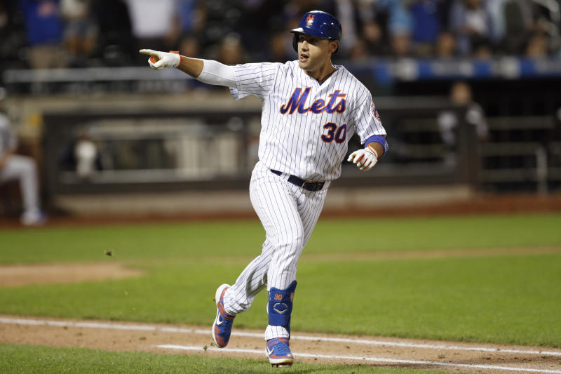 New York Mets' Michael Conforto points to the dugout after hitting a game-tying, two-run home run in the ninth inning of the team's baseball game against the Miami Marlins, Tuesday, Sept. 24, 2019, in New York. (AP Photo/Kathy Willens)