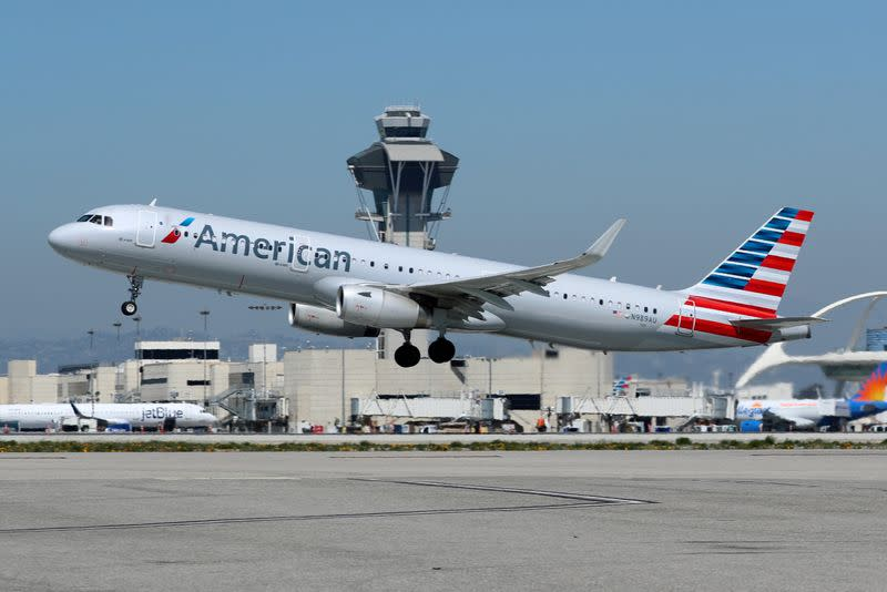 FILE PHOTO: An American Airlines Airbus A321 plane takes off from Los Angeles International airport