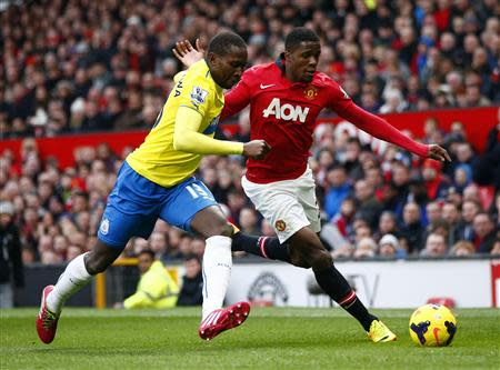 Manchester United's Wilfried Zaha (R) challenges Newcastle United's Mapou Yanga-Mbiwa during their English Premier League soccer match at Old Trafford in Manchester, northern England December 7, 2013. REUTERS/Darren Staples