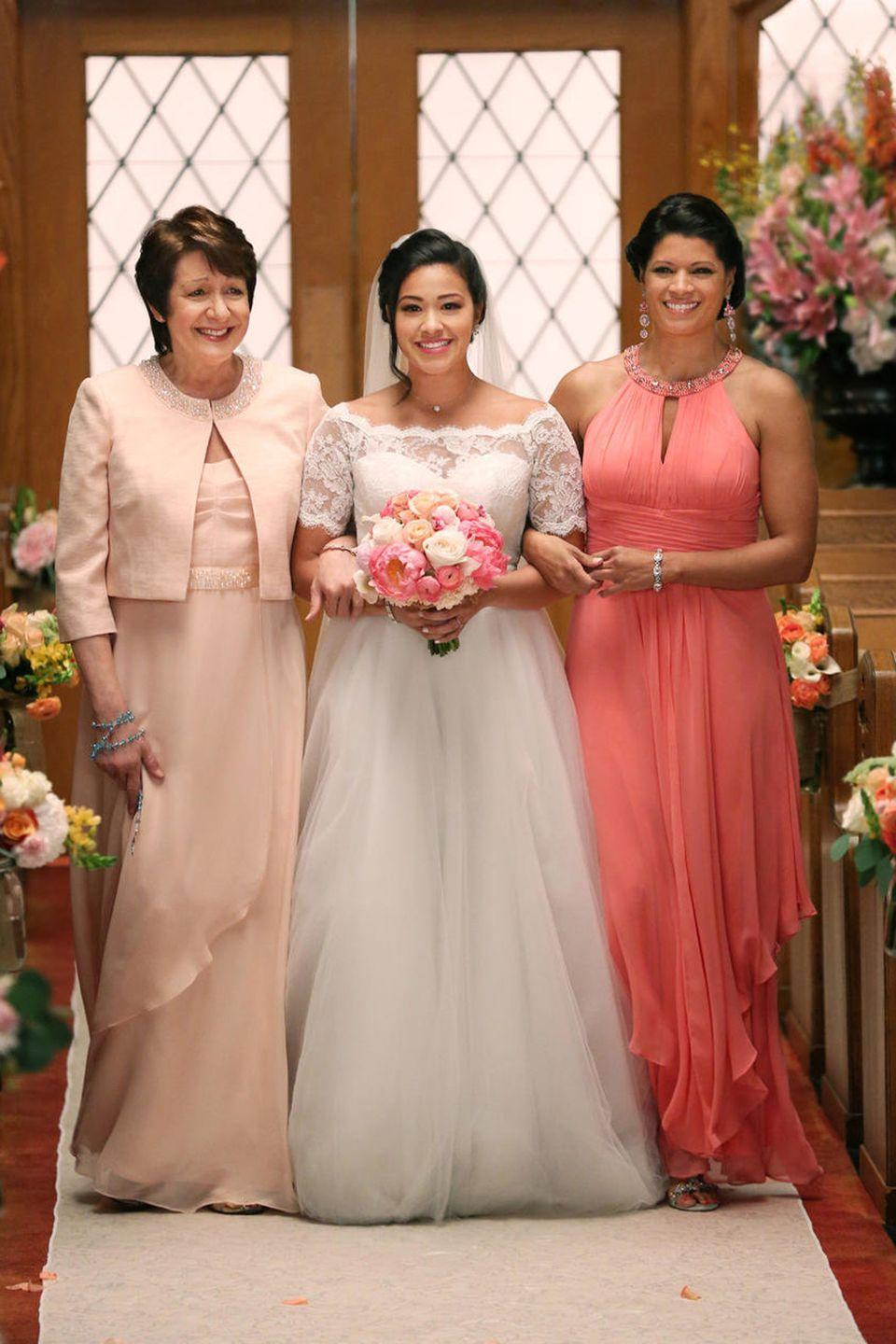 <p>Viewers were dying to see who Jane would end up with in the beginning of the show—Rafael or Michael—but in the end, she walked down the aisle to marry Michael in the season 2 finale. She wore a lace boatneck gown, pinning her hair in an elegant updo. </p>