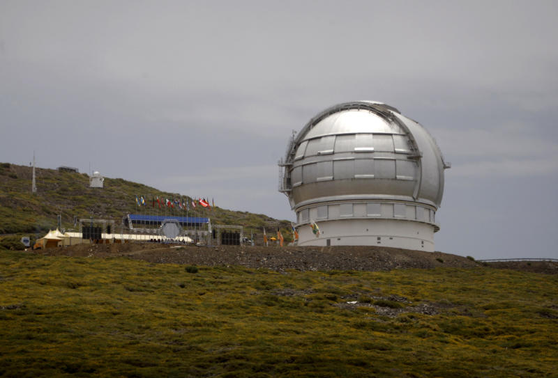 FILE--In this July 24, 2009, file photo, the Gran Telescopio Canarias, one of the the world's largest telescopes, is viewed at the Observatorio del Roque de los Muchachos on the Canary Island of La Palma, Spain. An agreement has been reached for a giant telescope to be built in Spain's Canary Islands if it cannot be put atop a Hawaii mountain. Telescope builder TMT International Observatory says Hawaii's Mauna Kea remains the preferred location for the $1.4 billion Thirty Meter Telescope. (AP Photo/Carlos Moreno, File)