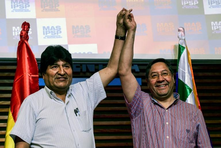 Bolivia's ex-President Evo Morales (L) with the candidate for his Movement for Socialism (MAS) party, Luis Arce, at a press conference in Buenos Aires (AFP Photo/RONALDO SCHEMIDT)