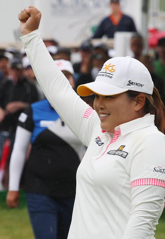 Inbee Park raises her fist after her final putt, winning the Manulife Financial LPGA Classic golf tournament Sunday, June 8, 2014, in Waterloo, Ontario. (AP Photo/The Canadian Press, Dave Chidley)