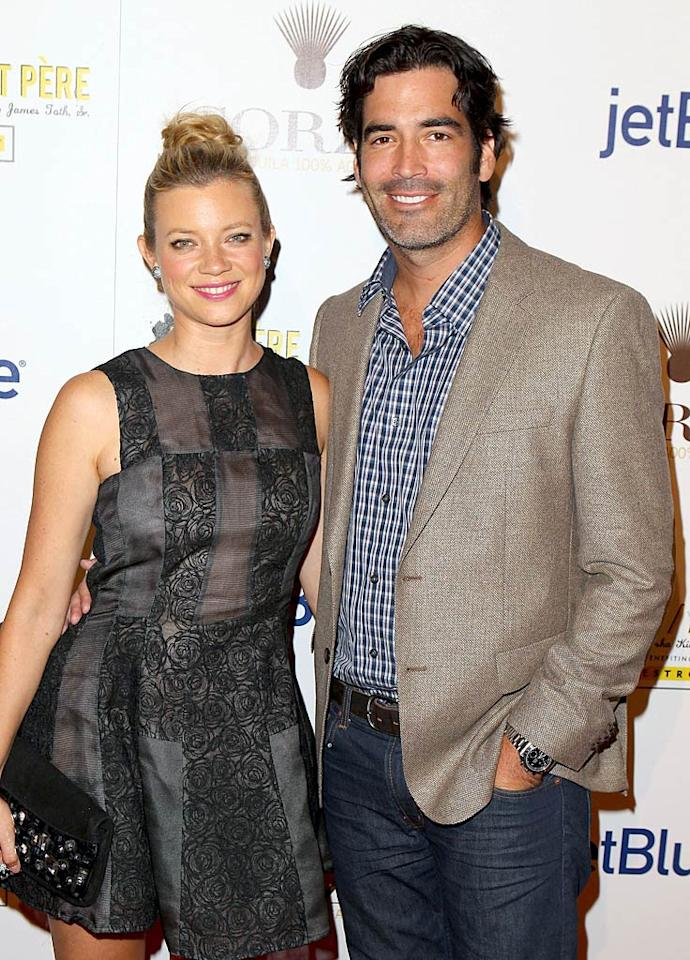"""Shameless"" actress Amy Smart and HGTV's Carter Oosterhouse were a perfect fit from the start! Not only are the two both ecologically minded -- they even met at an environmental charity event! -- but they've both got roots in Traverse City, Michigan, his hometown and the place her parents live. The pair said ""I do"" there in front of 215 guests on September 10."