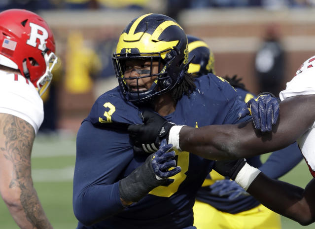 FILE – In this Oct. 28, 2017, file photo, Michigan defensive lineman Rashan Gary rushes against Rutgers during the first half of an NCAA college football game in Ann Arbor, Mich. The Wolverines could probably use a few more sacks out of the 6-5, 281-pound junior, and if he does improve his pass rush he could push to be No. 1 overall when the NFLs drafts next April. (AP Photo/Carlos Osorio, File)
