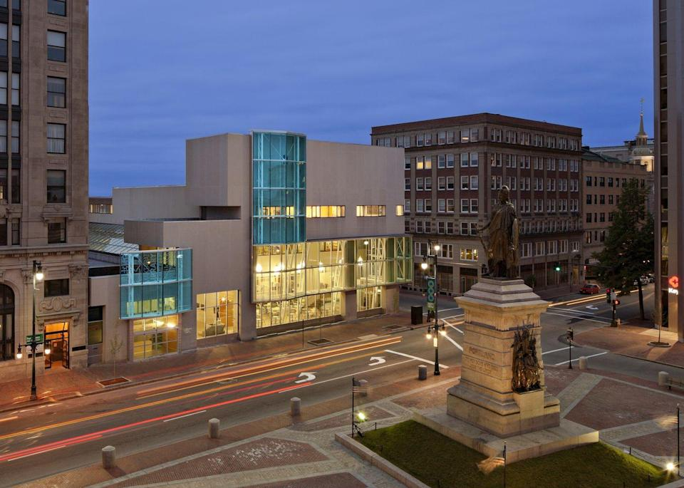 """<p>Maine's largest city is full of Victorian architecture, so this bright, <a href=""""http://portlandlibrary.com"""" rel=""""nofollow noopener"""" target=""""_blank"""" data-ylk=""""slk:modern building"""" class=""""link rapid-noclick-resp"""">modern building</a> with a glass façade truly stands out from the crowd.</p>"""