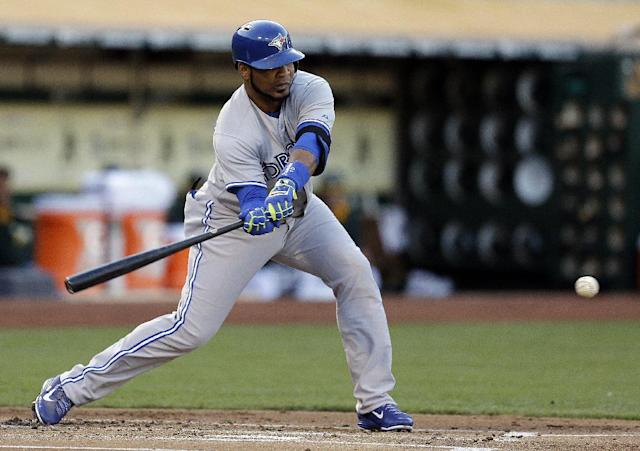 Toronto Blue Jays' Edwin Encarnacion grounds into a fielder's choice in the first inning of a baseball game against the Oakland Athletics on Saturday, July 5, 2014, in Oakland, Calif. Encarnacion left the game with an injury after tripping while running to first base. (AP Photo/Ben Margot)