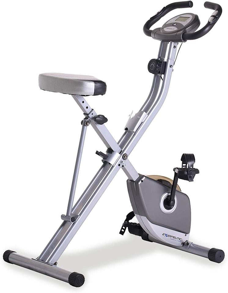 "For less than $200, here's an <a href=""https://www.amazon.com/Exerpeutic-Folding-Magnetic-Upright-Pulse/dp/B007595TKU"" target=""_blank"">exercise bike</a> you can fold up and roll off into a spare closet. With its magnetic tension control system, you can adjust the tension level for a variety of difficulty levels. We highly recommend setting it up in front of your laptop or TV so you can ride while watching some Netflix, which, bonus: This machine is quiet enough to not disturb your programs. The bike even features an LCD display that indicates distance, calories burned, time, speed, scan, and heart rate."