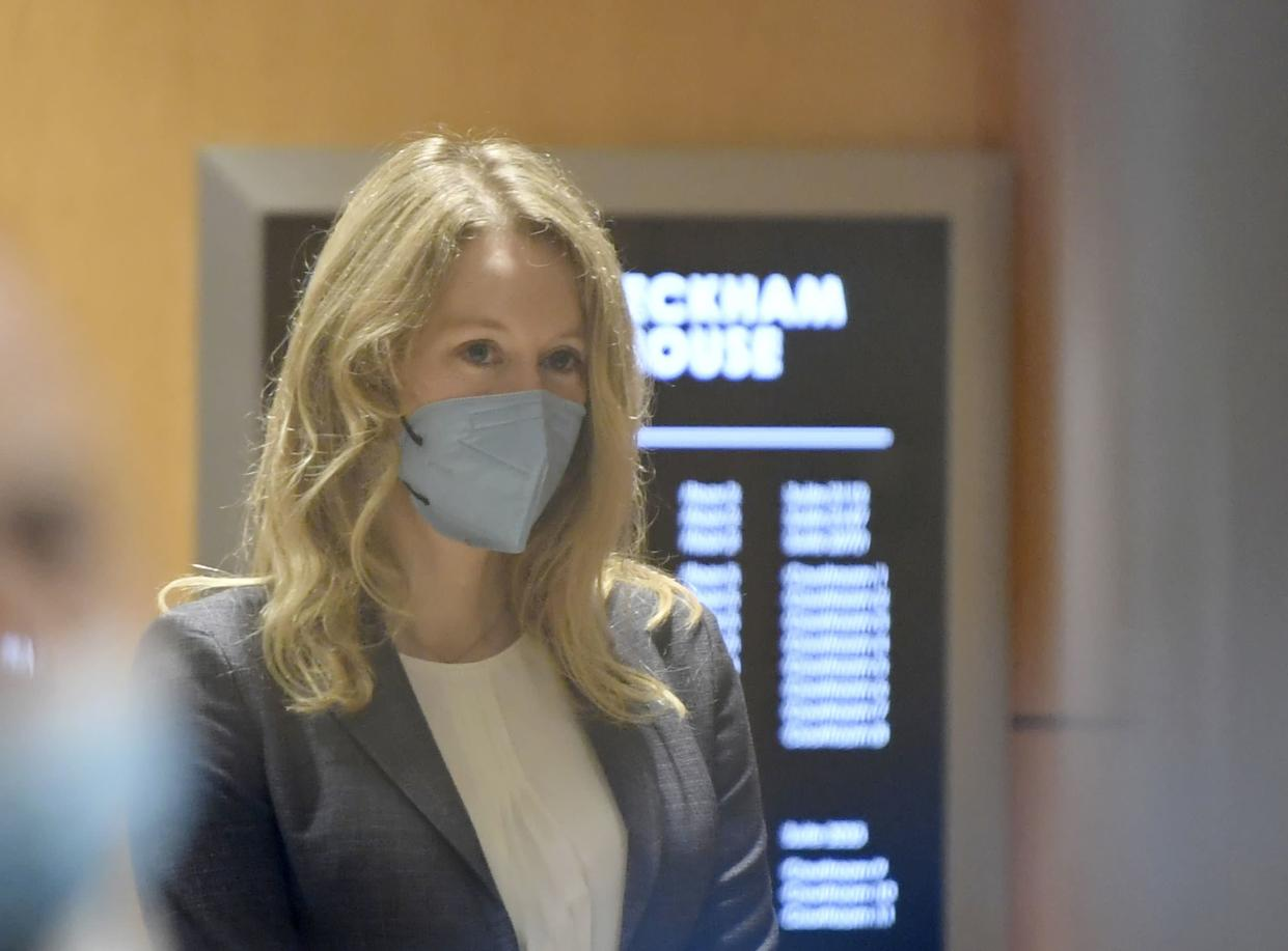 Elizabeth Holmes walks into the federal courthouse for her trial in San Jose, Calif., Wednesday, Sept. 8, 2021.