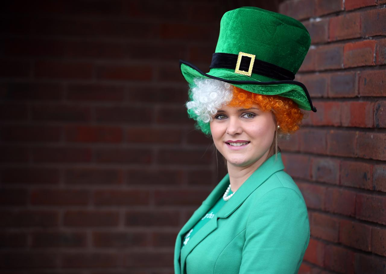 CHELTENHAM, ENGLAND - MARCH 14:  Racegoer Margaret Connolly poses wearing a costume for St Patrick's Thursday at Cheltenham Racecourse on the third day of the Cheltenham Festival 2013 on March 14, 2013 in Cheltenham, England. Approximately 200,000 racing enthusiasts are expected at the four-day festival, which opened on Tuesday and is seen as many as the highlight of the jump racing calendar. (Photo by Matt Cardy/Getty Images)
