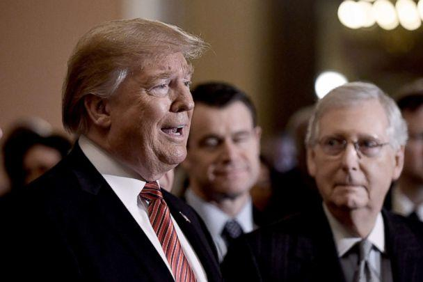 PHOTO: President Donald Trump talks to the press, as Senate Majority Leader Mitch McConnell looks on, after the Republican luncheon at the U.S. Capitol, Jan. 9, 2019, in Washington, DC. (Olivier Douliery/Getty Images)