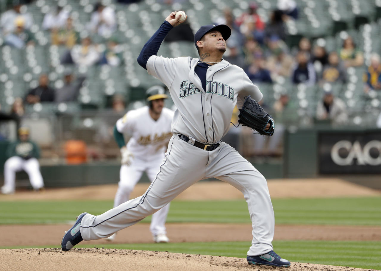Seattle Mariners starting pitcher Felix Hernandez throws to the Oakland Athletics during the first inning of a baseball game Thursday, May 24, 2018, in Oakland, Calif. (AP Photo/Marcio Jose Sanchez)