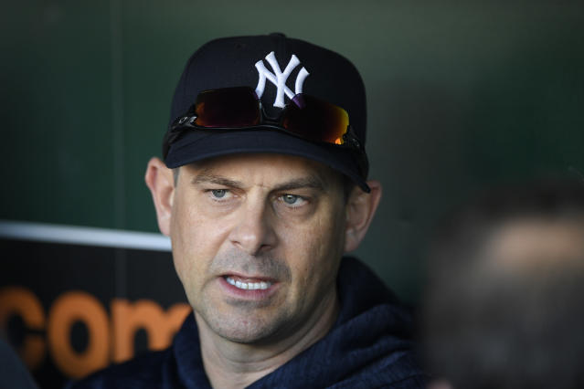 Aaron Boone is upset with his former employer. (AP Photo)