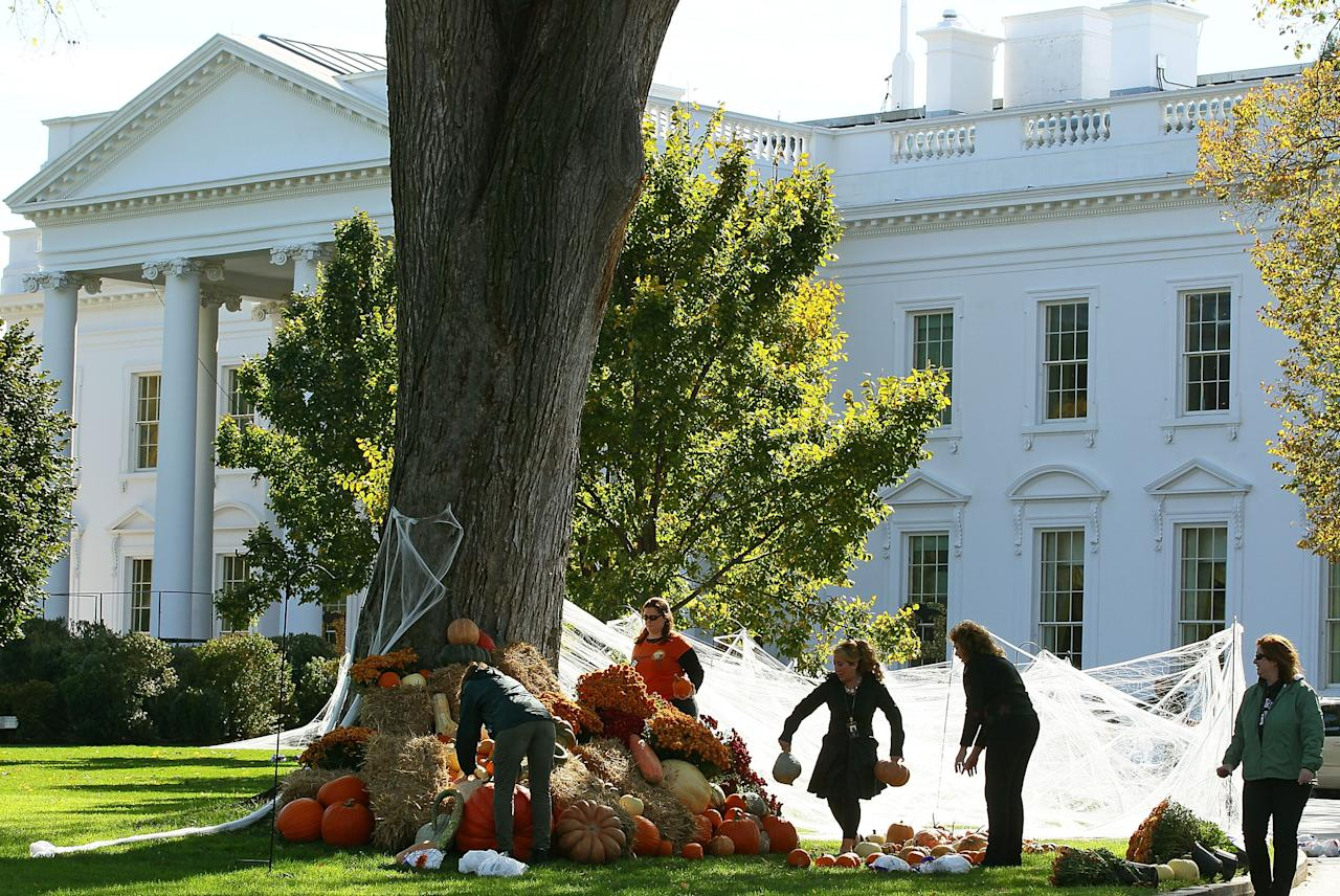 WASHINGTON, DC - OCTOBER 28:  Workers put up Halloween decorations on the north lawn of the White House October 28, 2011 in Washington, DC. U.S. President Barack Obama and first lady Michelle Obama will be hosting guests at the White House to celebrate Halloween.  (Photo by Mark Wilson/Getty Images)