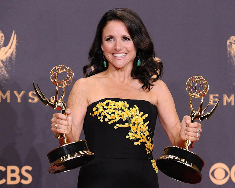 Julia Louis-Dreyfus holds up her Emmys at the Primetime Emmy Awards on Sept. 17, 2017, at Microsoft Theater in L.A. (Photo: Jason LaVeris/FilmMagic)