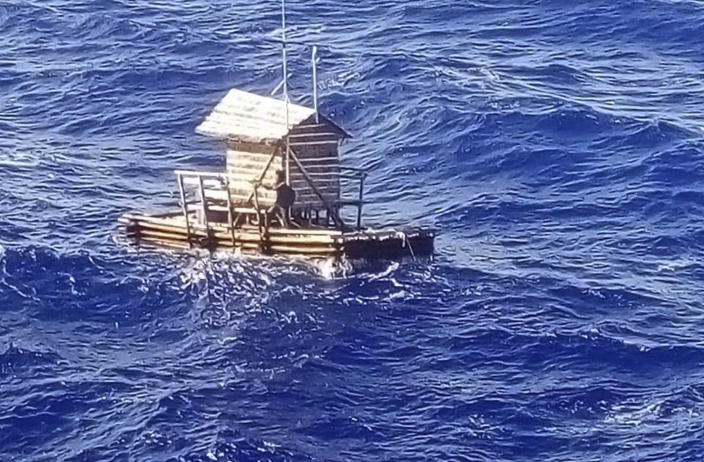 In this undated photo released by Indonesian Consulate General in Osaka, 18-year-old Aldi Novel Adilang is seen on a wooden fish trap floating in the waters near the island of Guam. The Indonesian teenager has survived about 7 weeks adrift at sea after the floating wooden fish trap he was employed to mind slipped its moorings. Aldi's parents and the Indonesian Consulate in Osaka, Japan, said he was rescued by a Panamanian-flagged vessel off Guam on Aug. 31 and returned to Indonesia earlier this month. (Indonesian Consulate General in Osaka via AP)