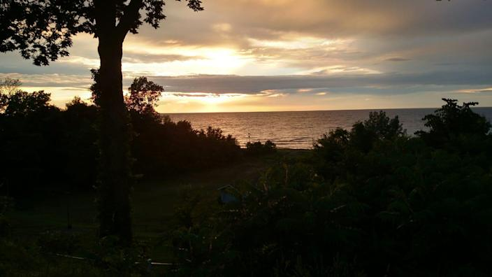 Chuckie Schultz would often send his sister, USA TODAY Columnist Connie Schultz, pictures of the sun setting over his back yard and Lake Erie.
