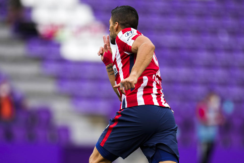 Atletico Madrid's Luis Suarez celebrates after scoring his side's second goal during the Spanish La Liga soccer match between Atletico Madrid and Valladolid at the Jose Zorrilla stadium in Valladolid, Spain, Saturday, May 22, 2021. (AP Photo/Manu Fernandez)