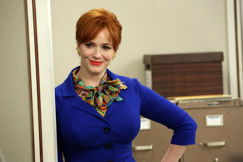 "This undated publicity image released by AMC shows actress Christina Hendricks, who portrays Joan Harris, in a scene from ""Mad Men."" Hendricks says she's feeling weepy as ""Mad Men"" approaches its seventh and final season. Hendricks said Thursday, Aug. 22, in Chicago that she plans on enjoying ""every second"" of filming when it resumes in November. Hendricks was in Chicago to host the opening of the city's Magnificent Mile Shopping Festival.. (AP Photo/AMC, Michael Yarish)"