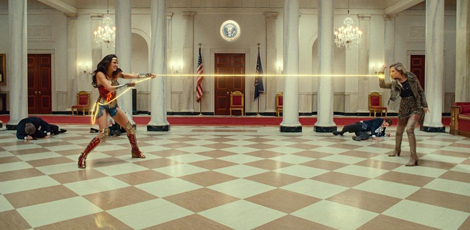 "Wonder Woman (Gal Gadot, left) and Cheetah (Kristen Wiig) tussle in the White House in ""Wonder Woman 1984."""