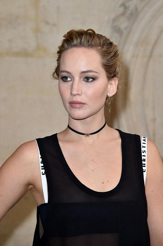 Jennifer Lawrence let the Dior bra peek out from under a tank top. (Photo: Getty Images)