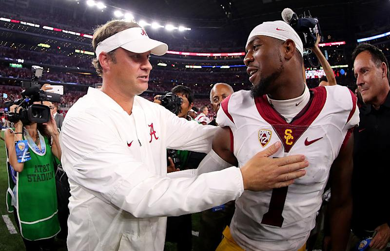 ARLINGTON, TX - SEPTEMBER 03: Offensive coordinator Lane Kiffin of the Alabama Crimson Tide talks with Darreus Rogers #1 of the USC Trojans after the Alabama Crimson Tide beat the USC Trojans 52-6 in the AdvoCare Classic at AT&T Stadium on September 3, 2016 in Arlington, Texas. (Photo by Tom Pennington/Getty Images)