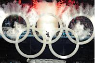 <p>During the Vancouver opening ceremony for the 2010 Winter Olympic Games, a snowboarder jumped through the Olympic rings on display. </p>