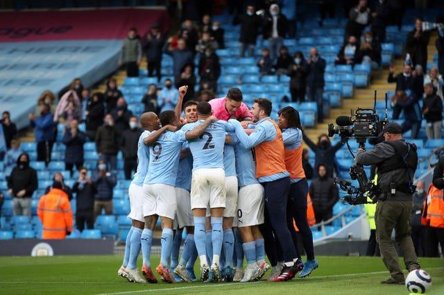 Manchester City players mob Sergio Aguero after his first goal