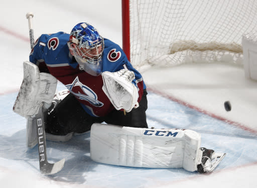Colorado Avalanche goaltender Semyon Varlamov watches as a shot off the stick of Toronto Maple Leafs right wing Kasperi Kapanen goes into the net for a tally in the first period of an NHL hockey game, Tuesday, Feb. 12, 2019, in Denver. (AP Photo/David Zalubowski)