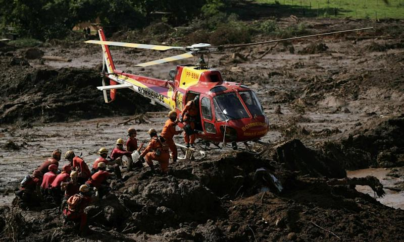 Firefighters search for victims of the Vale dam collapse in Brumadinho, Brazil.